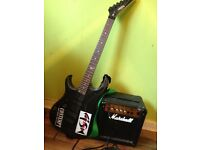 Left handed electric guitar and Marshall amp