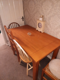 Large table with 3 chairs