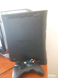 Xbox 360 with controller and skate 3