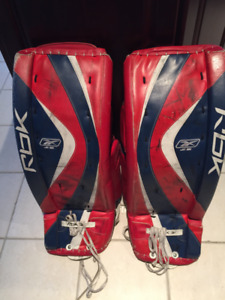 "RBK GOALIE PADS : RBK 6k JR (29""), red, blue, white."