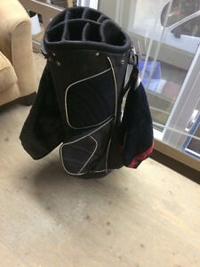 Black golf bag with nike golf towel no stand