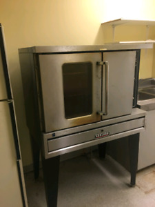 Garland Full size gas convection oven on a stand with racks.