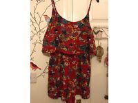 Red flowery playsuit size 10