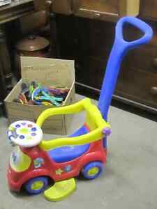 2007 HARD PLASTIC COLORED HANDLED STROLLER $10.00 FISHER PRICE