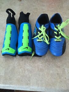 Boys 11T soccer cleats and shin pads