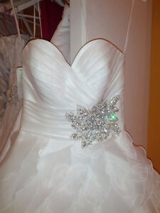 Unworn, unaltered wedding dress for sale
