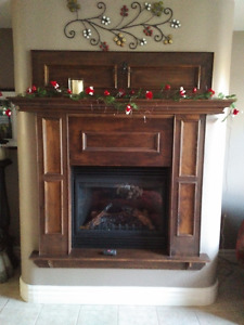 2006 Continental Propane Fireplace and Mantel