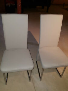 2 Brand New Matching Leather Chairs