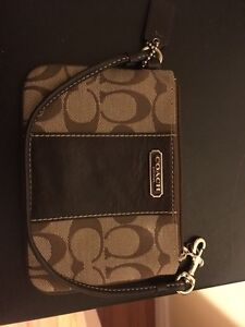 Beige and brown coach wristlet