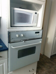 White fridge, wall oven, dishwasher, ceramic top range  microwav