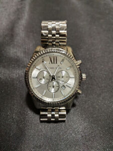 Micheal Kors Silver Men's watch and Golden women's watch