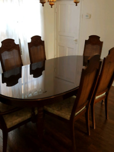 Dining room table with glass top and six chairs
