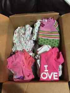 Box of girls 0-3 month clothes