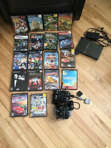 PS2 with extra controllers, cords and games