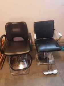 2 black and silver salon chairs