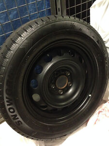 Set of Winter tires mounted on rims 215/60/R16
