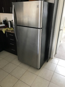 Kenmore Stainless Steel Refrigerator, Dishwasher and Stove.