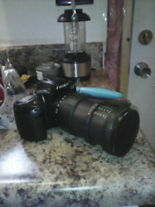 Classic Minolta camera and tarmon a spherical lens