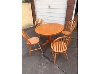 ROUND PINE TABLE AND 4 CHAIRS ** FREE DELIVERY AVAILABLE **