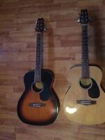 2 beginner guitars and soft case