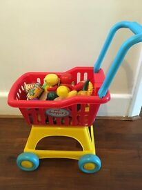 M&S shopping trolley with basket and food