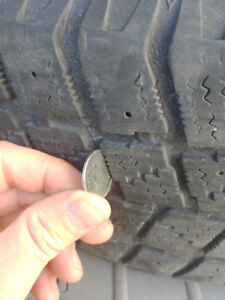 Winter tires+rims 205 65 r15.. used 2 seasons - $100