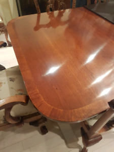 Mahogany dining table with 10 chairs and breakfronts