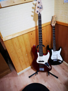 3 Guitars,an amp, & 2 stands. One bass,& one 3/4 size