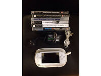 White PSP with official charger, earphones and games