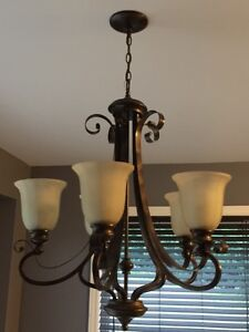 Three oil brushed chandeliers