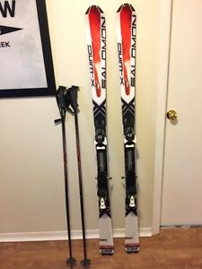 Men's Salomon downhill skis & poles