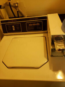 General Electric GE Coins Operated Washer and Dryer Set.