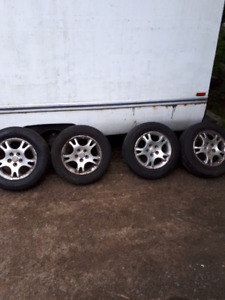 Set of 215/ 16 inch tires with rims excellent shape