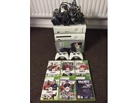 2 XBOX 360 with 2 control and 6 Games