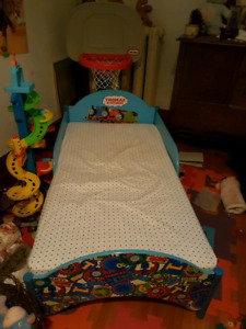 50 $$$Thomas the train toddler bed with mattress and new sheets