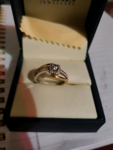 Mixed gold and silver .75 ct ring w/lifetime warranty