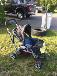 Double stroller baby in front toddler in back