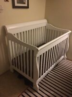 Solid wood white crib with mattress and matching white  dresser