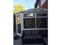 White PVC Conservatory, 4 windows and one door with roof.