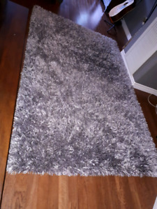 Mint condition 5 by 8 grey shag rug