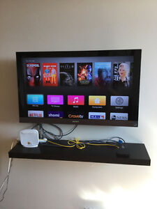 Plasma TV Sony Bravia + Wall shelf black for sale