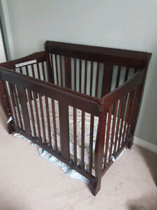 Storkcraft 4 in 1 crib (solid wood) and change table! Good cond.