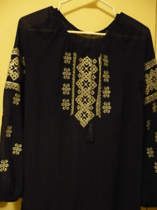 Woman  blouse with white colors embroidery.