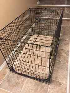 Dog crate with doggy bed