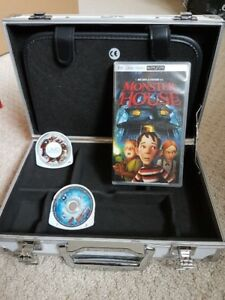 PSP Metal Carrying Case plus 2 Games and 1 movie