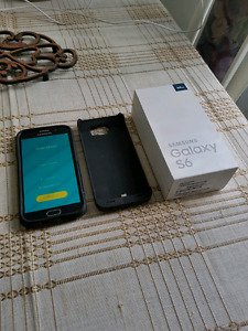 Samsung Galaxy S6 64 GB with Otter Box case and Charging case