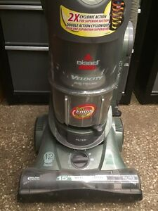 Upright vacuum - Bissell Velocity bagless canister.