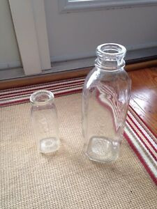 Vintage milk bottles - small and large