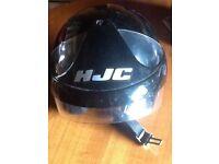 Three motorcycle helmets