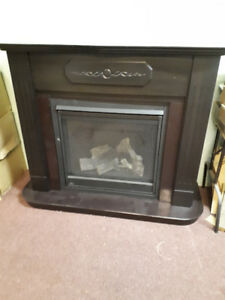 "Napoleon 36"" propane fireplace with Mantle and Surround"